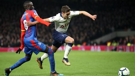 Crystal Palace's Cheikhou Kouyate (left) and Tottenham Hotspur's Harry Winks battle for the ball dur