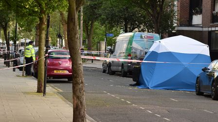 A forensics tent in Frampton Park Road on Friday afternoon. Picture: Polly Hancock