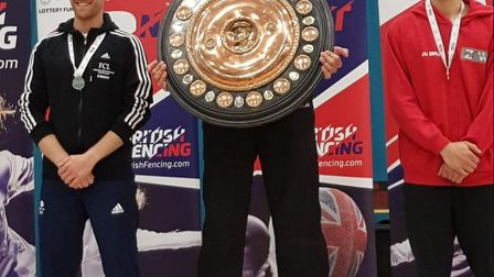 ZFW Fencing Club's James-Andrew Davis with the Senior National Champion's trophy (centre) and ZFW's