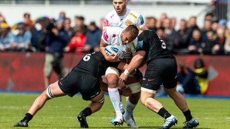 Exeter Chiefs' Sean Lonsdale and Saracens' Calum Clark and Saracens' Vincent Koch during the Gallagh