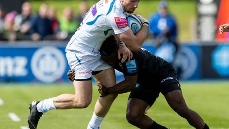 Exeter Chiefs' Alex Cuthbert and Saracens' Rotimi Segun during the Gallagher Premiership match at Al