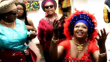 Beatrice Awigo in a music video 'Holy Ghost Party' in which she sings in Ridley Road, wearing clothe