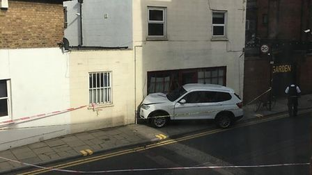 The car had smashed into the woman's home in Stoke Newington.