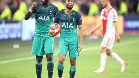 Tottenham Hotspur's Moussa Sissoko (left) and Lucas Moura (centre) celebrate after the final whistle