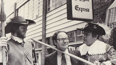 Gerry Isaaman poses with soldiers outside the Ham&High offices in Perrin's Court. Picture: Isaaman F