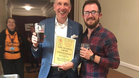 Dick Morgan with an award for another of his pubs, the Sussex Arms in Twickenham. Picture: Dick Morg
