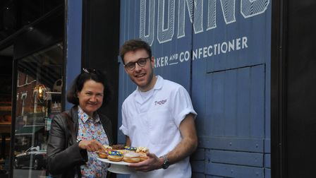 Catherine West and Lewis Freeman outside Dunn's Bakery, ahead of the 28th National Doughnut Week, in