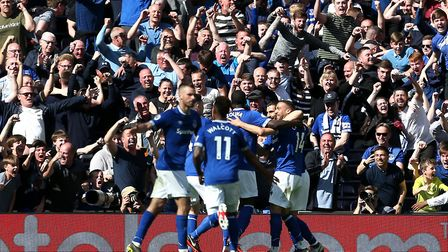 Everton's Cenk Tosun (right) celebrates his side's second goal against Tottenham Hotspur (pic: Steve