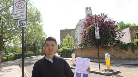 Eric Luk Man Hon with the PCN issued to him next to the bus gate. He thinks the signs are not visibl