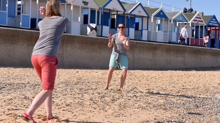 People enjoying the warm weather along the coast of Southwold.Kathryn Mudge and Mel Berry messing ro