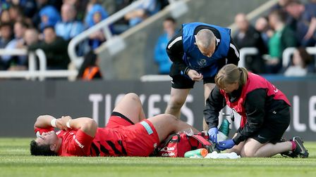 Saracens Titi Lamositele suffers an injury during the Champions Cup Final at St James' Park, Newcast