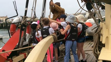 Children from St Faith's Primary School, in Horsham St Faith, visit the Excelsior ship in Lowestoft.