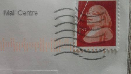 The franked fake stamp with Diane Abbott's face on it.