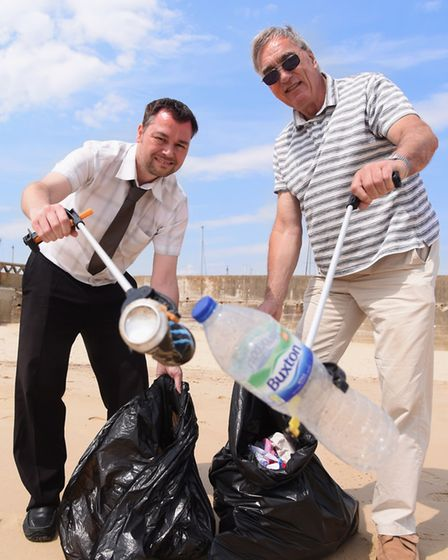 Mark Boggis, left, EDP reporter, and Mick Howes, from the Lowestoft Summer Festival, kicking off the