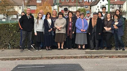 Neighbours demonstrate outside of the old Templars Tennis Club in Temple Fortune. Picture: Rohit Gro