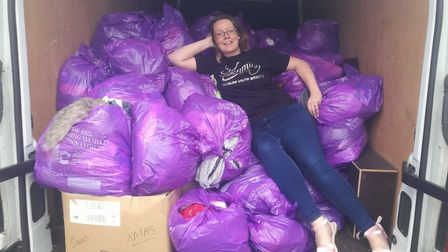 Weight loss consultant Ali Burrell with the bags of donated clothes. Picture: Coutesy of Ali Burrell