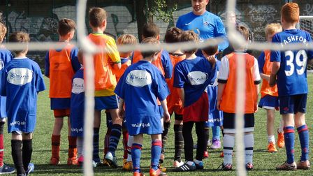 Tony Hassan teaching his football team, the Soccaroonies. Picture: Anthony Hassan