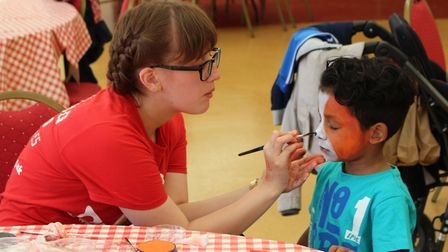 One child gets his face painted by a staff member at Noah's Ark Children's Hospice. Picture: NACH