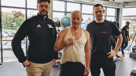 Peter Sergeant with Tom Astley (left) and Jack Foord (right) who saved his life. Picture: Sam Volpe