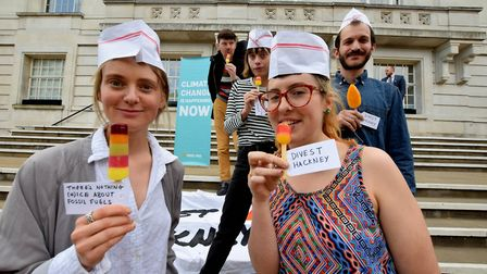 Divest Hackney campaigners on the steps of Hackney Town Hall giving out ice lollies to symbolise how
