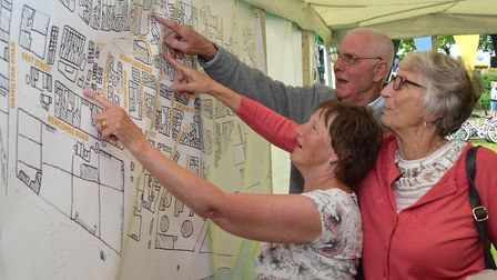 The GritFest - a celebration of Lowestoft's beach village. Visitors look at the beach village plans.