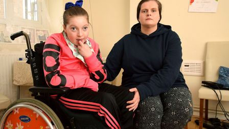 Marian Court resident Margaret Mongan, with her severely disabled daughter Annmarie Mongan, nine. Pi