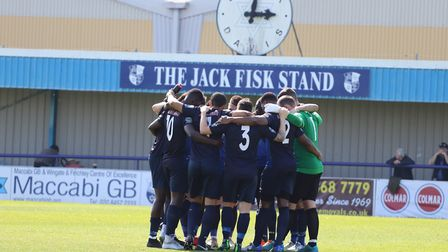 Wingate & Finchley players have a group huddle before a game (pic: Little James Photography).