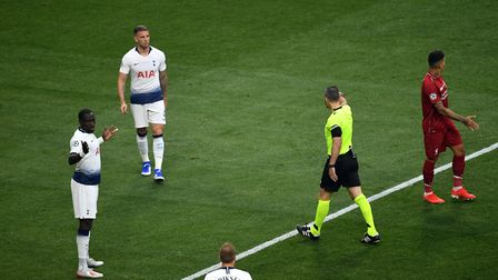 Tottenham Hotspur's Moussa Sissoko (left) concedes a penalty resulting in the opening goal scored by