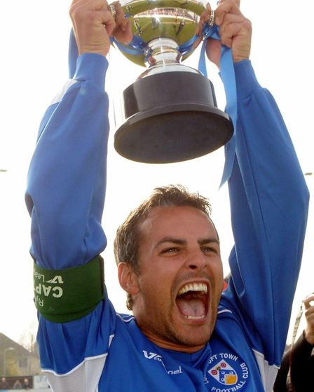 Lowestoft Town celebrate winning the Ryman Division 1 North.; Jamie Godbold with the trophy.; Photo: