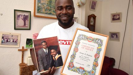 Antonn Christophe, grandson of James Boston with a photo of James in 1980 and his certificate of ser