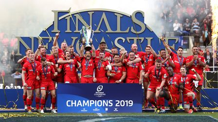 Saracens celebrate with the trophy after the Champions Cup Final at St James' Park, Newcastle.