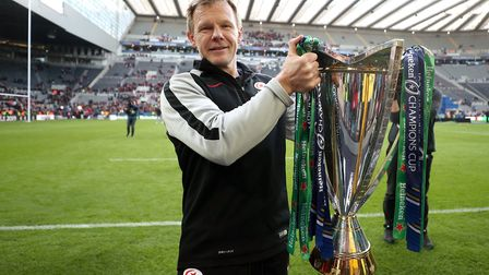 Saracens director Mark McCall celebrates with the trophy after the Champions Cup Final at St James'