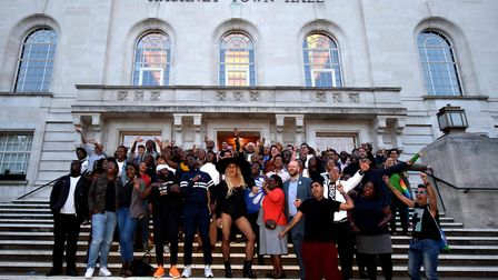 Organisers and supporters UK Black Pride pose on the steps of Hackney Town Hall. Picture: Polly Hanc