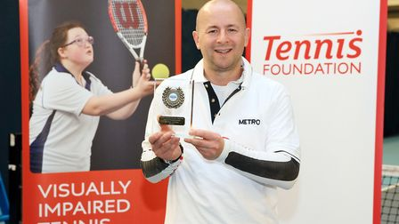 Paul Ryb shows off his latest medal. Picture: LTA / James Jordan