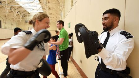 Hackney Downs ward officers Pc Monica Denkewicz and Pc Dillon Patel join in the activities at a Box-