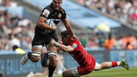 Exeter Chiefs' Sam Skinner (left) avoids a tackle from Saracens' Sean Maitland during the Gallagher