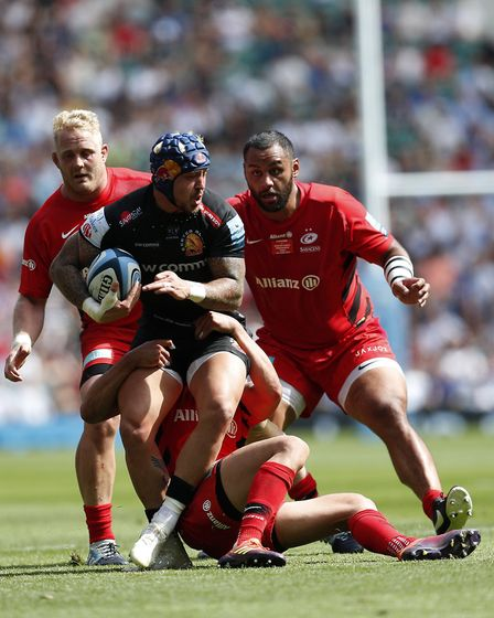 Exeter Chiefs' Jack Nowell (centre) is tackled by Saracens' Alex Lozowski during the Gallagher Premi