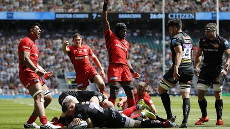 Saracens' Ben Spencer (hidden) scores a try against Exeter Chiefs during the Gallagher Premiership F