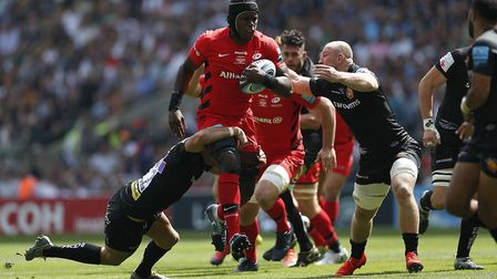 Exeter Chiefs' Ollie Devoto (left) and Matt Kvesic tackle Saracens' Maro Itoje (centre) during the G