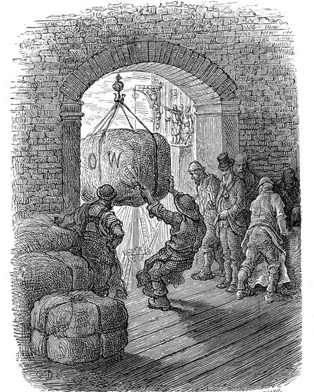 Vintage engraving showing a scene from 19th Century London England. Porters unloading goods into a w