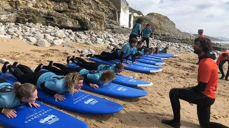 Surfers warm up before getting in the sea. Picture: Emma Bartholomew
