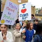 Children and parents from William Patten Primary Schools march down Church Street in April to protes