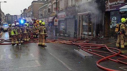 Green Lanes is closed to traffic while the blaze which has affected Nonno's pizzeria and Havin patis