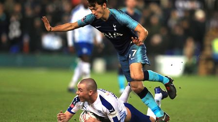 Tranmere Rovers' Luke McCullough (left) and Tottenham Hotspur's George Marsh battle for the ball (pi