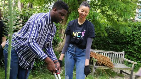 Co-chair of the Hackney Young Futures Jermain Jackman (left) volunteers at Groundwork community gard