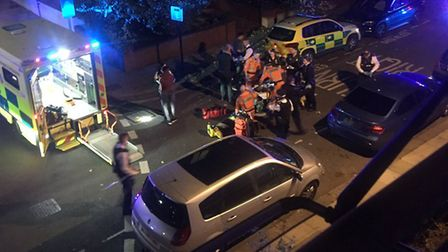 Police and ambulance staff at the scene of the West Hampstead stabbing of a 17 year old off Lithos R