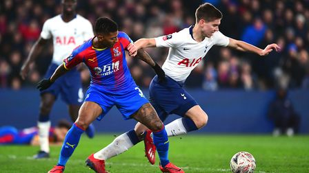 Crystal Palace's Patrick van Aanholt (left) and Tottenham Hotspur's Juan Foyth battle for the ball d