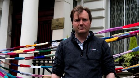 Richard Ratcliffe outside the Iranian Embassy in front of the symbolic knitted chains. Picture: Josh