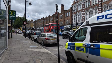 The scene shortly after a motorcyclist was taken to hospital in Crouch End Hill. Picture: Sam Volpe