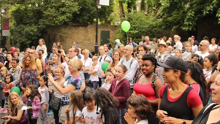 The crowd looks on as performers entertain visitors. Picture: Shanei Stephenson-Harris
